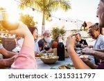 happy family doing a dinner... | Shutterstock . vector #1315311797