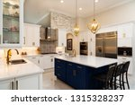 Stock photo beautiful luxury home kitchen with white cabinets 1315328237
