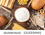wheat products on dark wooden... | Shutterstock . vector #1315334441