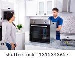 smiling repairman repairing... | Shutterstock . vector #1315343657