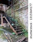 gdr factory steel staircase | Shutterstock . vector #1315364177