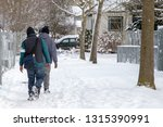 two people walking in the snow | Shutterstock . vector #1315390991