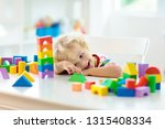 kid playing with colorful toy...   Shutterstock . vector #1315408334