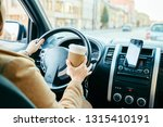 woman driving car and drinking...   Shutterstock . vector #1315410191