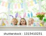 kids dyeing easter eggs.... | Shutterstock . vector #1315410251