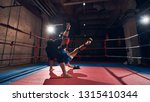 sporty boxer training mma with... | Shutterstock . vector #1315410344