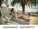 woman on a lounger by the pool... | Shutterstock . vector #1315439777