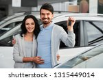 happy young couple with keys... | Shutterstock . vector #1315449014