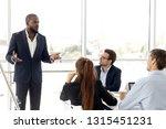confident african boss giving... | Shutterstock . vector #1315451231