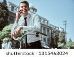 businessman riding a bicycle to ... | Shutterstock . vector #1315463024