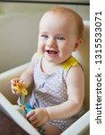 little baby girl sitting in... | Shutterstock . vector #1315533071