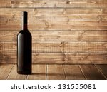 Red Wine Bottle On A Wooden...