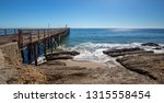 fishing pier and boat hoist at... | Shutterstock . vector #1315558454