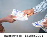 Small photo of a man Making payments,giving bribe. a hand receiving payment, bribe