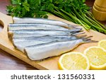 Stock photo raw herrings on wooden board 131560331