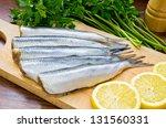 Stock photo raw herrings on wooden board 131560331