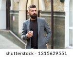 man bearded hipster drinking... | Shutterstock . vector #1315629551