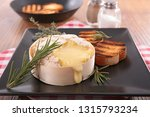 melted camembert and rosemary | Shutterstock . vector #1315793234