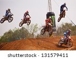Постер, плакат: Group of motocross riders