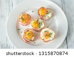 bacon and egg cups on the white ...   Shutterstock . vector #1315870874