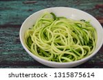 raw zucchini noodles or zoodles ... | Shutterstock . vector #1315875614
