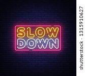 slow down neon sign vector....   Shutterstock .eps vector #1315910627