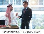 arabian businessman discussing... | Shutterstock . vector #1315924124