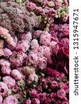 Small photo of Beautiful blossoming freshly delivered flowers at the florist shop: cymbidium orchids, peony hermione ranunculus, roses, carnations, ozotamnus, eustoma in ombre pink and magenta colors