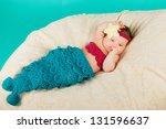 cute newborn baby girl wearing... | Shutterstock . vector #131596637