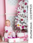 the little girl at a white... | Shutterstock . vector #131599925
