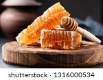 honeycomb and wooden honey... | Shutterstock . vector #1316000534