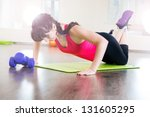 Pretty young girl fitness workout in gym - stock photo