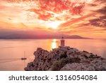 .Beautiful sunset in the lighthouse in Melagavi cape at Loutraki, Greece.