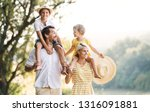 young family with small... | Shutterstock . vector #1316091881