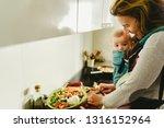 Busy Mother Preparing Food In...
