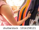 women try wearing a gown to... | Shutterstock . vector #1316158121