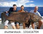 Fishermen Holding A Giant...