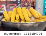 a large bowl of boiled corn at... | Shutterstock . vector #1316184701
