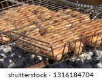 pork sausages are cooked on the ... | Shutterstock . vector #1316184704