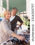 senior tourist couple visiting... | Shutterstock . vector #1316203757