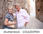 mature tourist couple together... | Shutterstock . vector #1316203904
