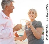 mature couple on holiday ...   Shutterstock . vector #1316203907