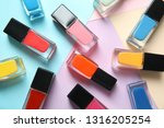 bottles of nail polish on color ... | Shutterstock . vector #1316205254