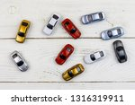 cars toys on white wooden... | Shutterstock . vector #1316319911