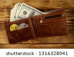 wallet with american hundred... | Shutterstock . vector #1316328041