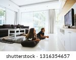 two teenagers watching tv while ... | Shutterstock . vector #1316354657