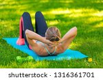 young fit woman doing abdominal ... | Shutterstock . vector #1316361701