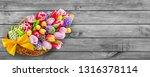 springtime flowers and basket... | Shutterstock . vector #1316378114