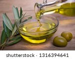 bowl with olive oil on wooden... | Shutterstock . vector #1316394641