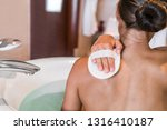 woman taking a bath at luxury... | Shutterstock . vector #1316410187